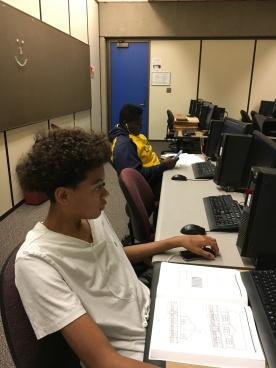 At computers