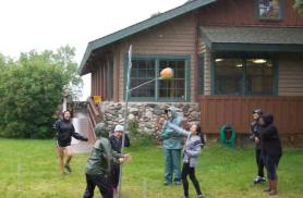AV Eagle Convo playing tetherball in rain pre-trail
