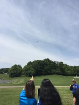 Girl flying drone outside