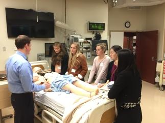 Sim Lab Girls with sim patient